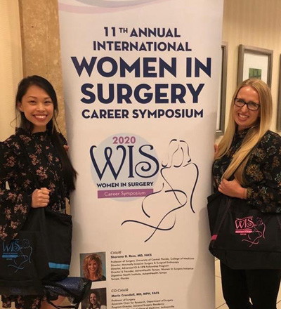 Tina van Loon by banner at Women in Surgery Career Symposium 2020